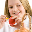Happy girl painting easter egg — Stock Photo