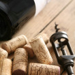 Corkscrew next to the bottle of red wine — Stock Photo