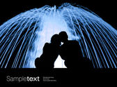 Lovers nex to the blue fountain — Stock Photo