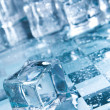 Stock Photo: Ice cubes in blue ambient light.
