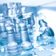 Chess board and pieces in blue ambient l — Stock Photo
