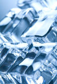 Ice cubes in blue ambient light. Good fo — Stock Photo