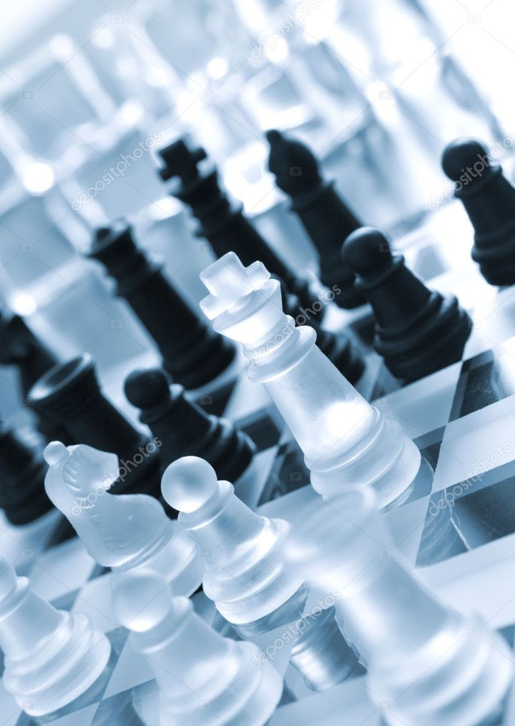 Black and transparent white pieces of chess on chess board made of glass  — Stock Photo #2027238