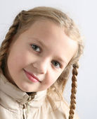 Little girl with braids — Stock Photo