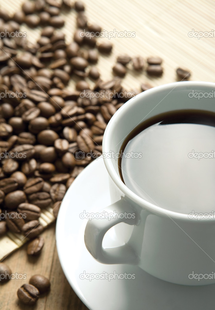 White cup of coffee on coffee beans  Stock Photo #2101768