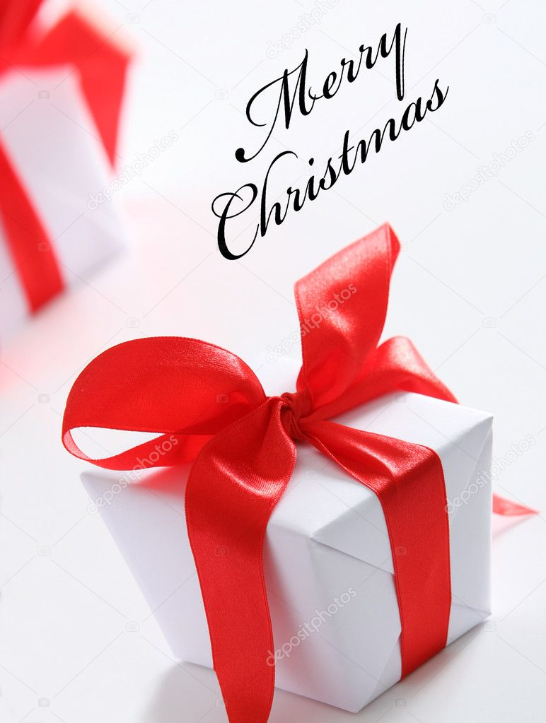 White gift boxes with red ribbon on white background — Stock Photo #2103689