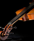 Old violin on black — Stock Photo