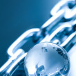 Abstract chain and globe made of glass — Stock Photo