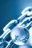 Abstract chain and globe made of glass — Zdjęcie stockowe