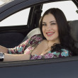 Stock Photo: Happy woman in the car