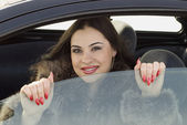 Girl in the car — Stock Photo