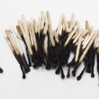 Stock Photo: Burnt matchsticks