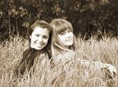 Girls in grass — Stock Photo