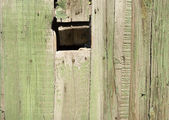 Hole in wooden fence — Stock Photo