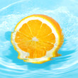 Orange in splash — Stock Photo
