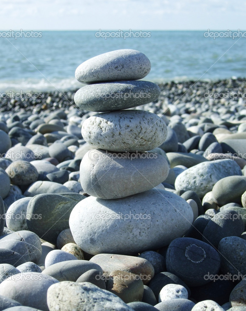 Stack of a pebbles stones on a beach — Stock Photo #1821227