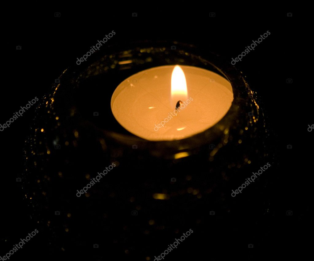 A candle over black background  Stock Photo #1822498