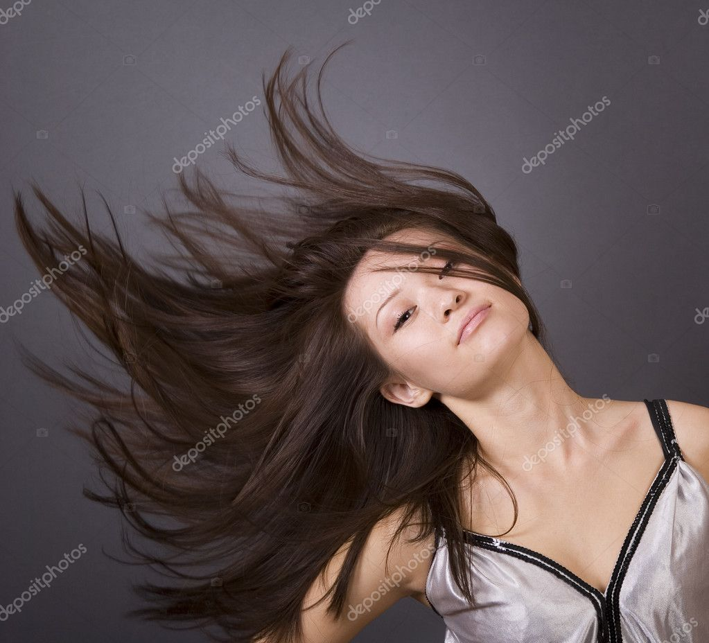 Portrait of young beautiful woman over grey — Stock Photo #1829114
