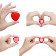 Heart symbol in hands — Stock Photo