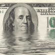 Dollars in water — Stock Photo
