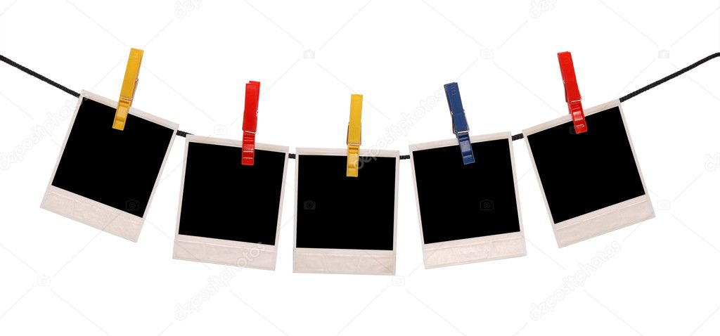 Photo frames on a rope isolated on white — Stock Photo #1879230