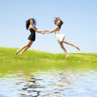 Two jumping woman - Stock Photo