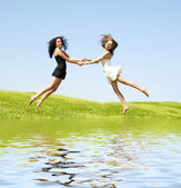Two jumping woman — Foto de Stock