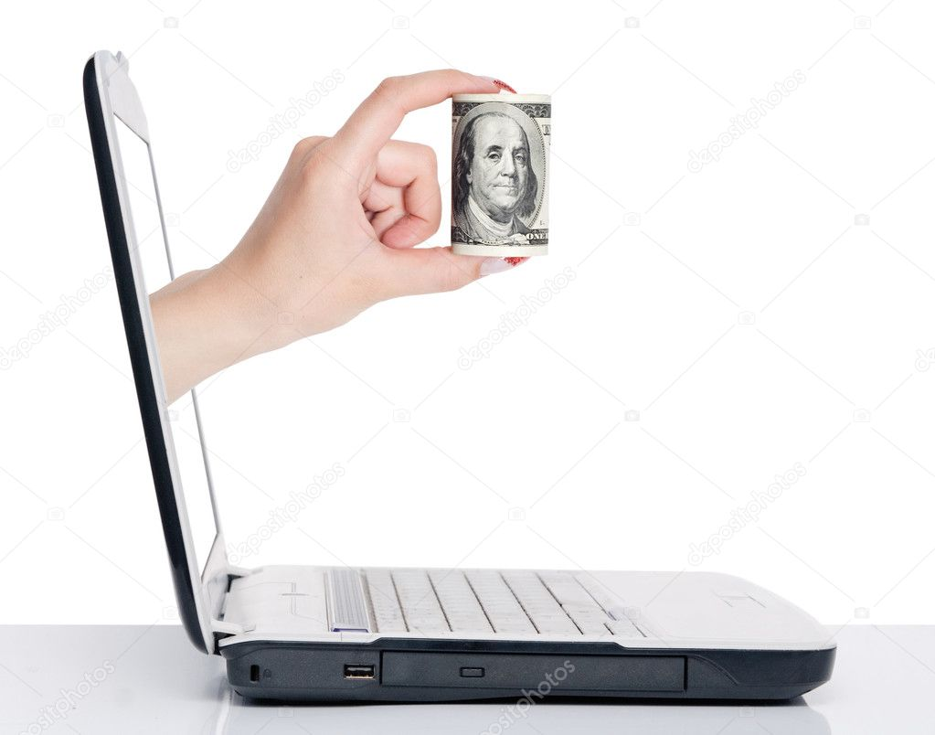 Hand with money comes from laptop screen isolated on white — Stock Photo #1880435