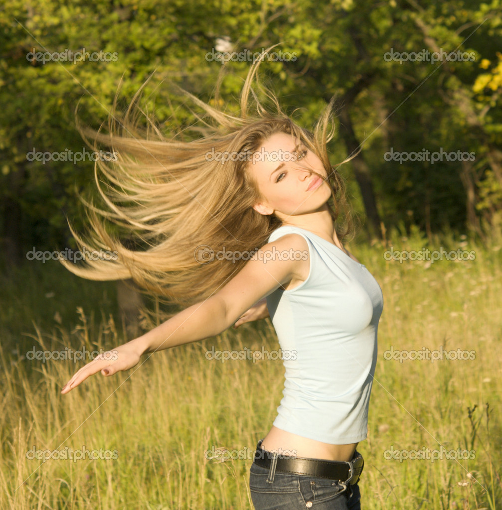 Young pretty woman with long hair — Stock Photo #1881123