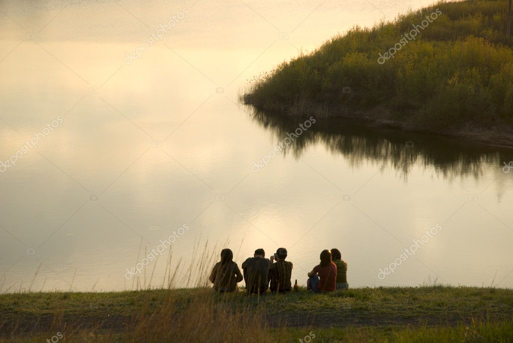 Young sitting watching the sunset. — Stock Photo #1884602