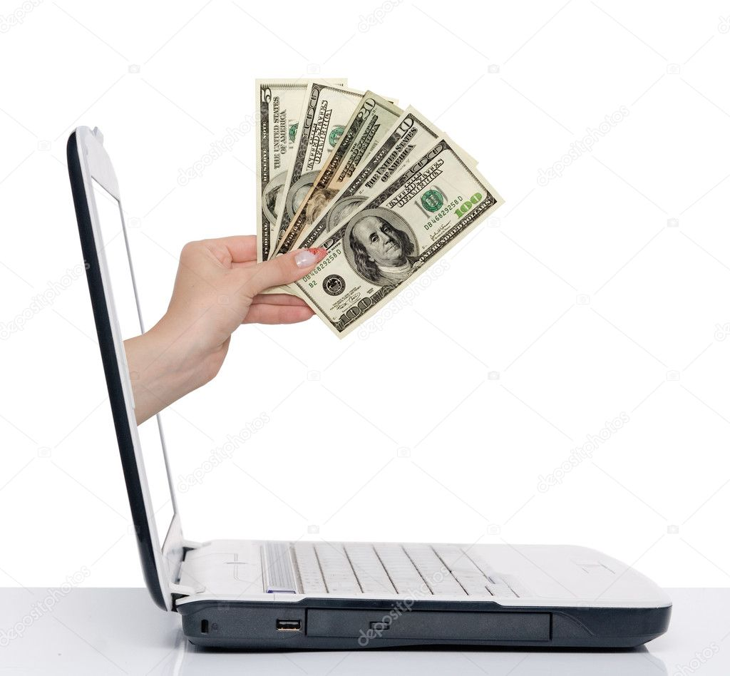 Hand with money comes from laptop screen isolated on white — Zdjęcie stockowe #1885139