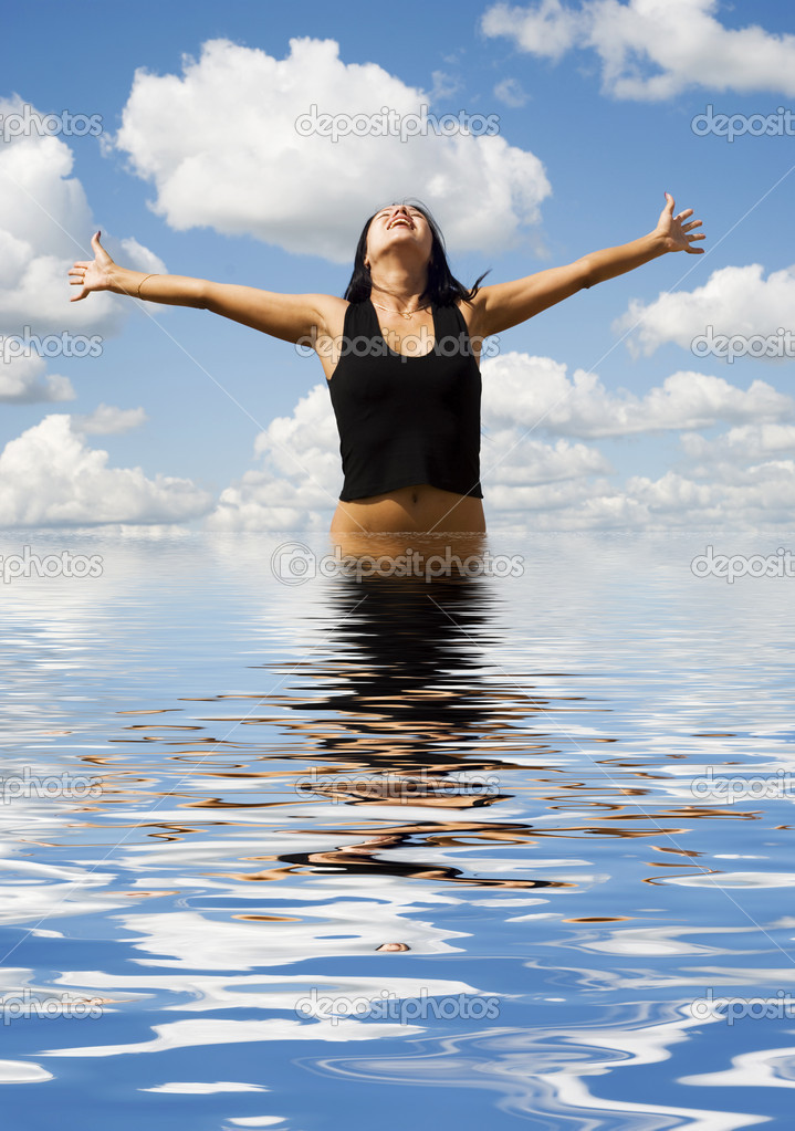 Beautiful woman in water over sky background — Stock Photo #1889055