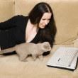 Woman and cat — Stock Photo