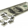 Dollar puzzle - Stock Photo