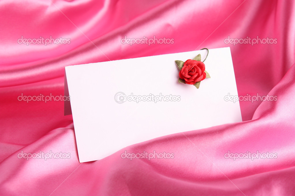 Pink rose with  white card on  silk background  Stock Photo #1995839
