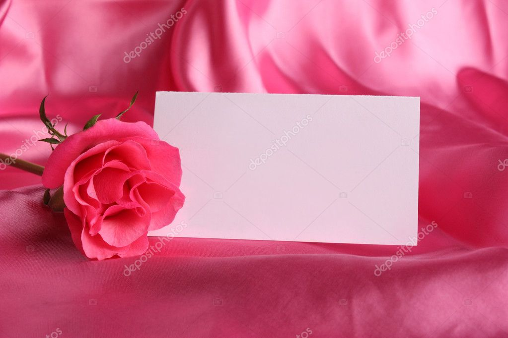 Pink rose with  white card on  silk background — Stock Photo #1995885