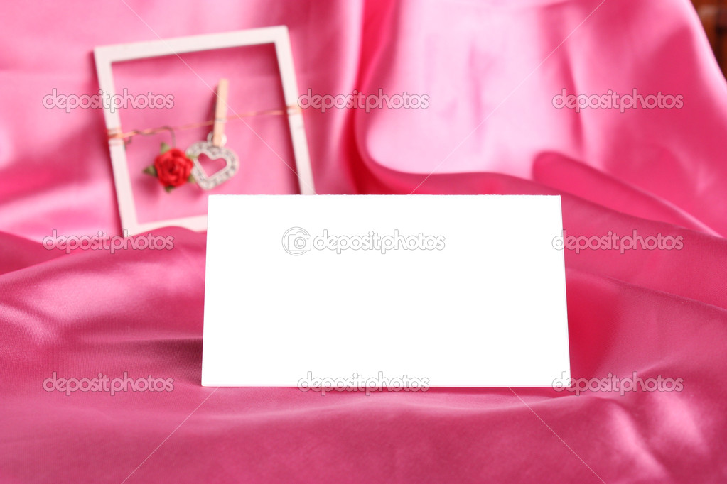 Pink rose with  white card on  silk background — Stock Photo #2383214