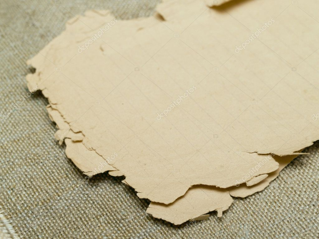 Very old yellowed paper on an old cloth background — Stock Photo #1811187