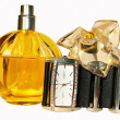 Stock Photo: Women's perfumes and watches