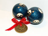 Chinese balls and three coins — Stock Photo
