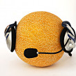 Muskmelon in headphone — Stock Photo