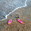 Flip-flop on sea beach — Stock Photo