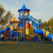 Colorful public playground in garden — Stock Photo #1806121
