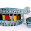 Measuring tape and spools of threads — Stock Photo
