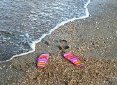 Flip-flop on sea beach — Stock Photo