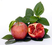 Pomegranate and apple — Stock Photo