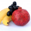 Royalty-Free Stock Photo: Banana, pomegranate,  and grapes