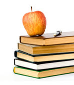 Pile of books and apple — Stock Photo
