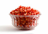 Pohár plný arils granátové jablko — Stock fotografie