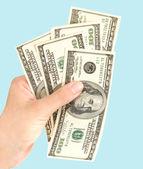 De la mano con dólares — Foto de Stock